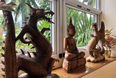 Modern-2-Story-Beach-House-for-Sale-Wooden-Statuettes